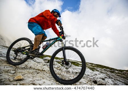 Mountain biking in the Dolomites, Tre Cime di Lavaredo, Italy.