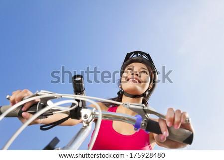 Mountain biking - portrait of young mountain biker - stock photo