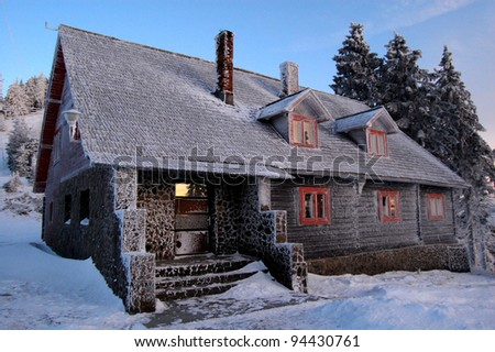 Mountain cabin during winter - stock photo