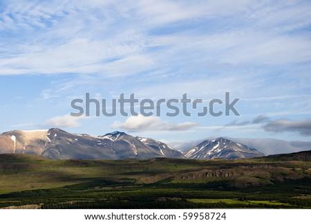 Mountain chain near Egilsstadir, East Iceland. - stock photo
