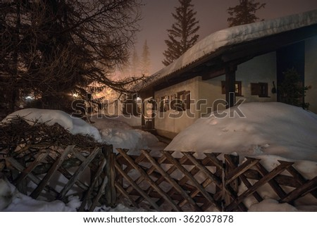 Mountain chalet in winter Alps in night lights