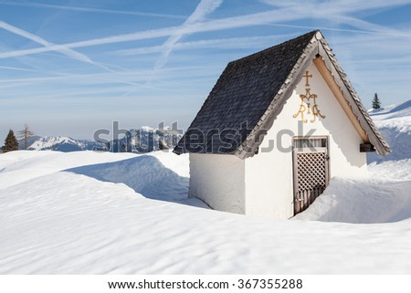 Mountain chapel at winter landscape.