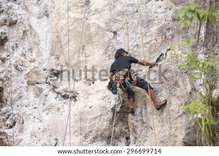 mountain climber at riley beach, Krabi, Thailand - stock photo