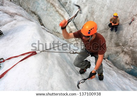 Mountain climber on the mountain top in fine weather - stock photo