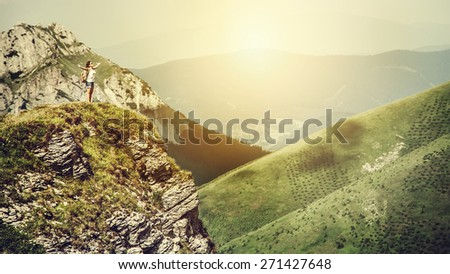 Mountain climber on the top of hill  - stock photo