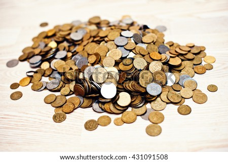 Mountain coins on wooden background - stock photo