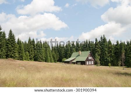 mountain cottage - stock photo