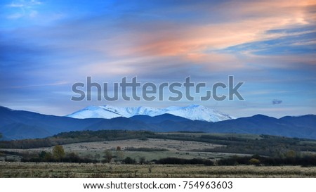 Mountain covered in snow in late Autumn