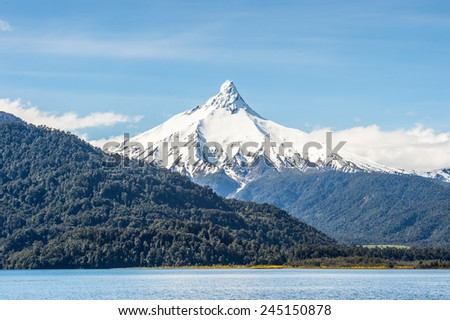 Mountain covered with snow in the Vicente Perez Rosales National Park, Sector Puella, Chile, South America - stock photo