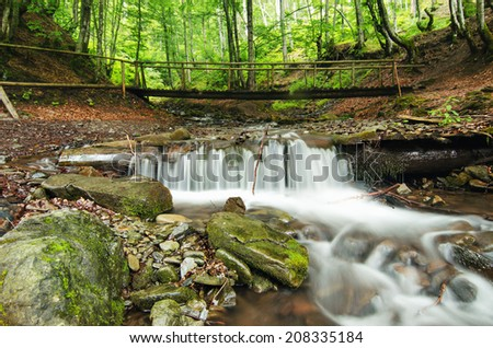 Mountain fast flowing river Shipot waterfall stream of water in the rocks