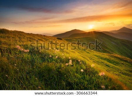 Mountain field during sunset. Beautiful natural landscape - stock photo
