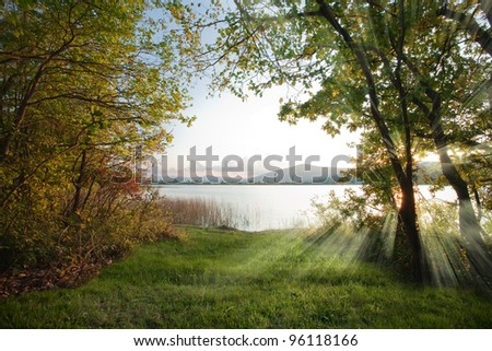 Mountain forest lake at dawn - stock photo