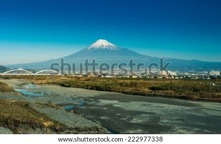 mountain fuji and fuji river from shizuoka prefecture - stock photo
