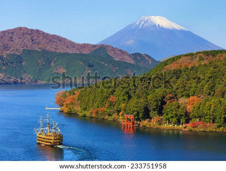 Mountain Fuji and Lake Ashi with Hakone temple and sightseeing boat in autumn - stock photo