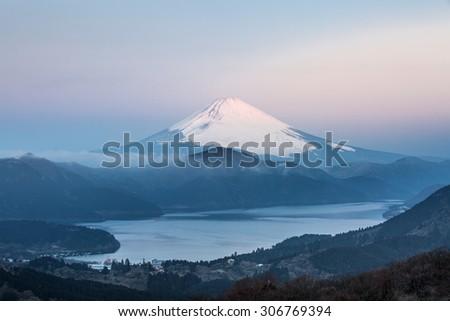 Mountain Fuji in winter sunrise at Hakone Lake - stock photo