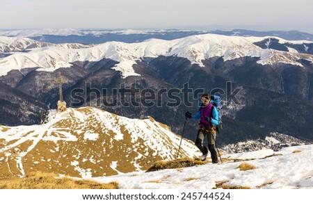 Mountain girl exploring at winter - stock photo