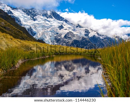 Mountain Glacier and little pond in Southern Alps, New Zealand - stock photo
