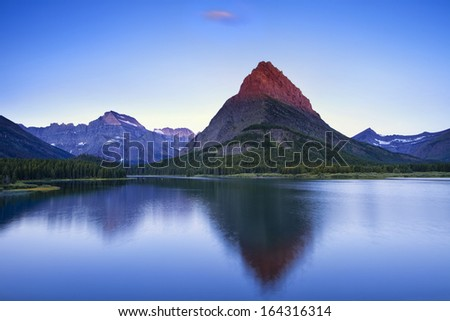 Mountain glowing at sunrise - stock photo