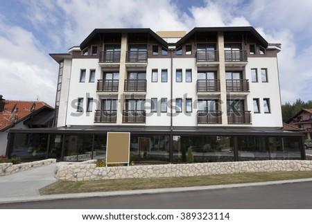 Mountain hotel exterior - stock photo