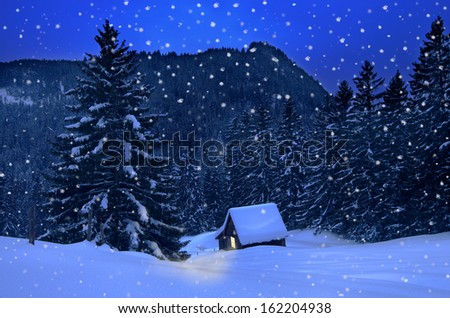 mountain hut in winter with snowflakes at christmas - stock photo
