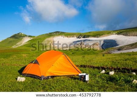 Mountain in Caucasus under blue sky - stock photo