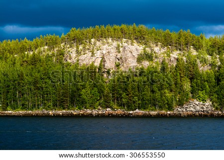 Mountain in the sunlight. The river and the sky blue. Russia north - stock photo