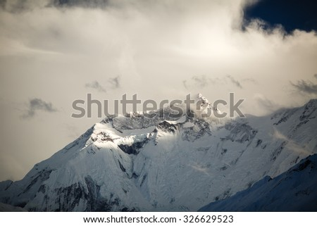 Mountain inspirational landscape in Himalayas, Annapurna range, Nepal. Mountain ridge with ice and snow over clear blue sunny sky.