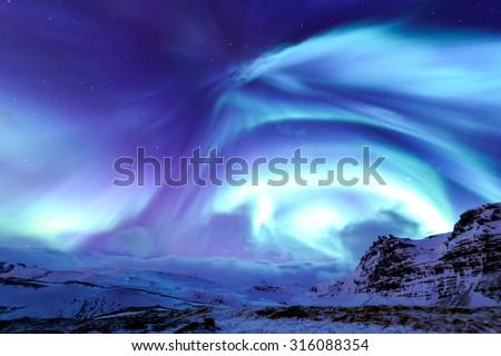 Mountain Kirkjufell and Aurora in Iceland. - stock photo