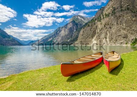 Mountain lake and boats. Seton Lake in Lillooet, Vancouver, Canada. Beauty world. - stock photo