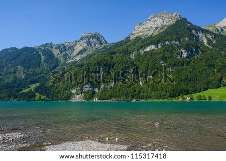 Mountain lake at Kloental, Glarus, Switzerland - stock photo