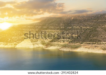mountain lake at the sunset - stock photo