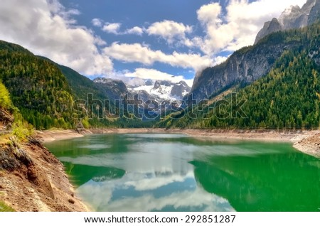 Mountain lake in Austrian Alps. View of Hoher Dachstein and Mitterspitz from the lake Vorderer Gosausee in Austria.