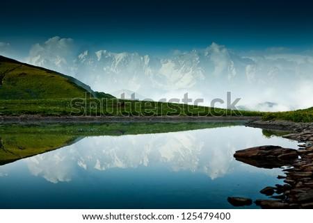 Mountain lake in Caucasus mountains in Svaneti Georgia - stock photo