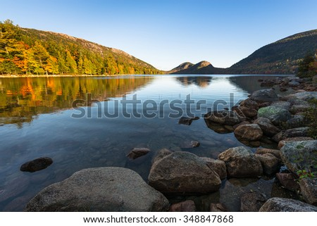Mountain Lake in Early Autumn Sunlight - stock photo