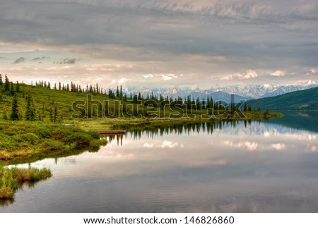 Mountain lake in early morning light in Denali National Park. - stock photo