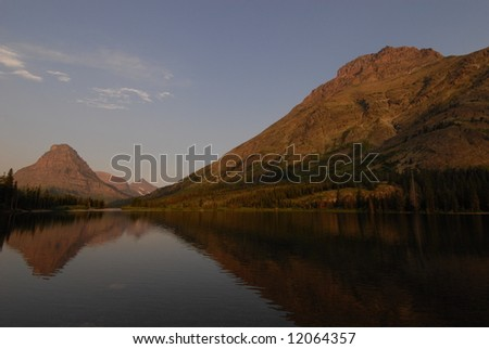 Mountain lake in Glacier National Park - stock photo