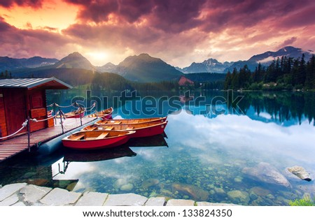 Mountain lake in National Park High Tatra. Dramatic overcast sky. Strbske pleso, Slovakia, Europe. Beauty world. - stock photo