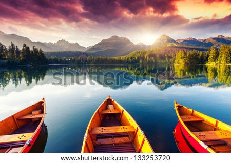 Mountain lake in National Park High Tatra. Dramatic overcrast sky. Strbske pleso, Slovakia, Europe. Beauty world. - stock photo