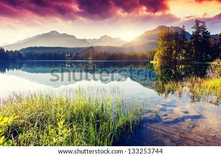 Mountain lake in National Park High Tatra. Dramatic overcrast sky. Strbske pleso, Slovakia, Europe. Beauty world. - stock photo