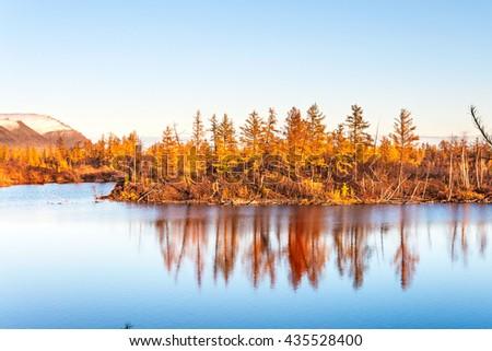 Mountain lake in tundra, deep autumn in the Taimyr Peninsula near Norilsk.  - stock photo
