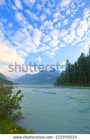 Mountain Lake Kucherlinskoe and River under beautiful cloudy sky, Altai, Siberia, Russia - stock photo