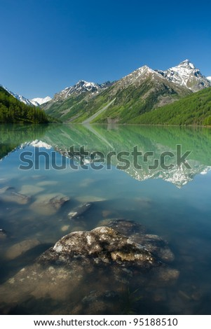 Mountain lake Kucherlinskoe with  stones on foreground, Altay, Russia