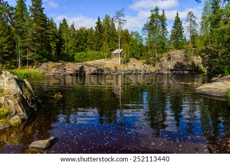 Mountain lake landscape surrounded with forest with abor - stock photo