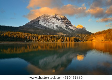 Mountain lake with reflection and fog at sunset in Banff National Park, Canada. - stock photo