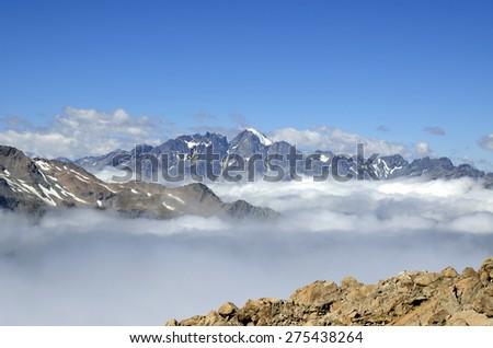 Mountain landscape above clouds blanket in Aoraki National park, NZ. - stock photo
