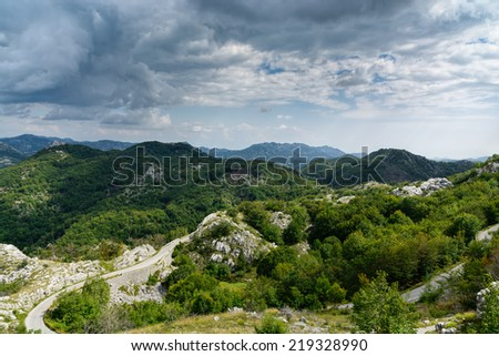 Mountain landscape and road in summer - stock photo