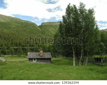 Mountain landscape and  wooden cabin in Sweden
