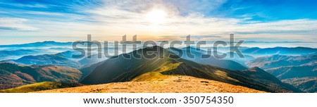 Mountain landscape at sunset. Panorama of beautiful view on hills - stock photo