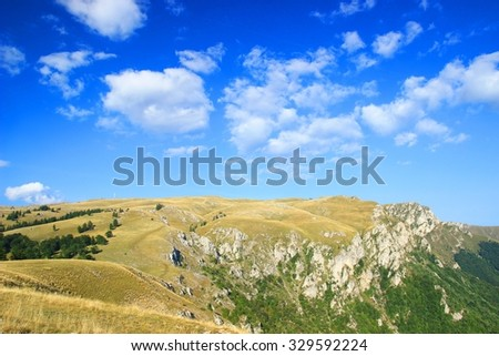 Mountain landscape, blue sky with clouds