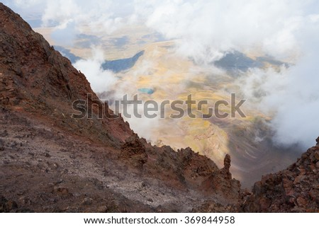 Mountain landscape in Armenia with rocks and little blue lake - stock photo